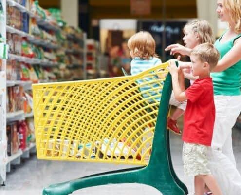 mother and kids having fun playing grocery shopping games