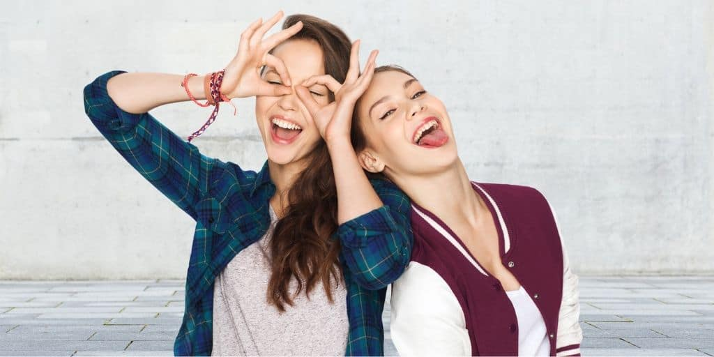two young teen girls goofing off
