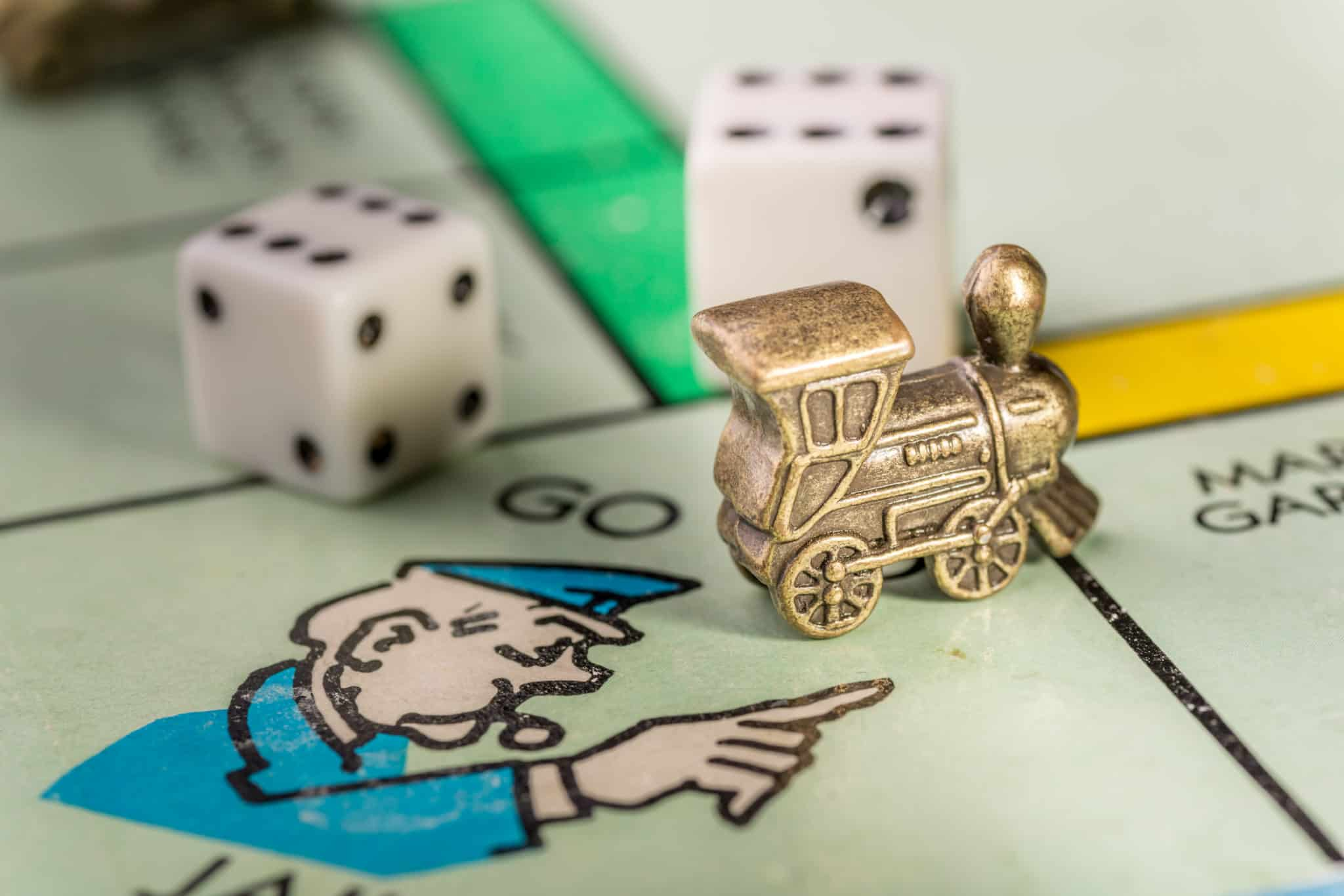 Train monopoly piece on go to jail space