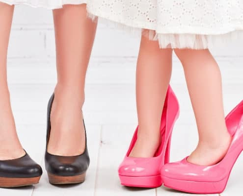 shows mother and daughter's feet in beautiful, adult-sized, high heels, ready for take your child to work day