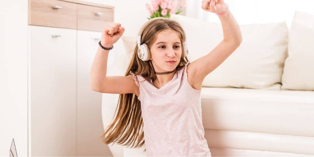 young teen dancing with headphones on