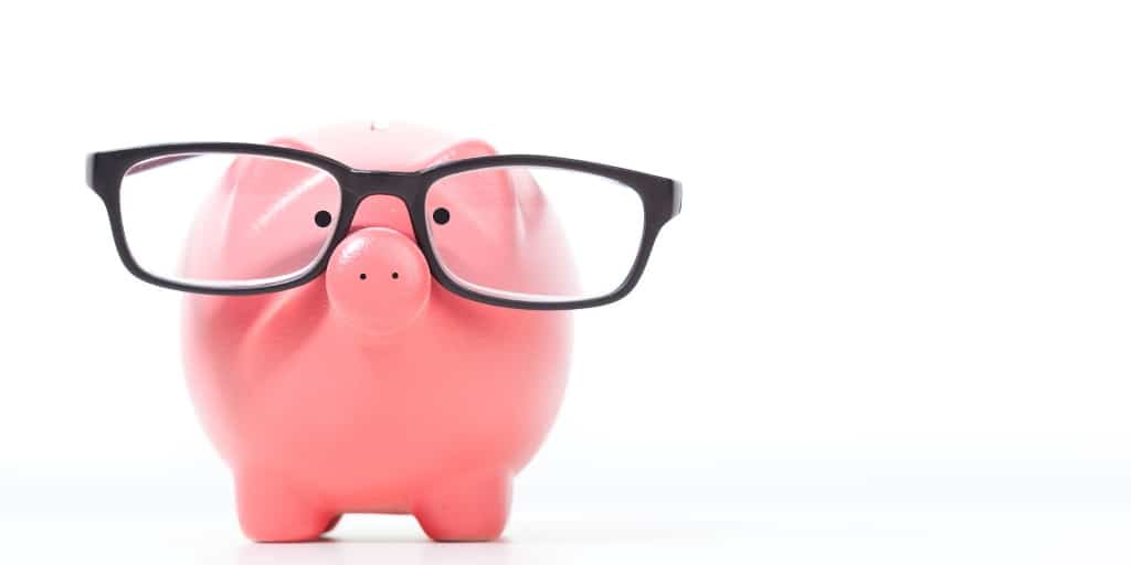 piggy bank with black glasses on it