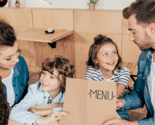 family in a restaurant with a menu, getting ready to order