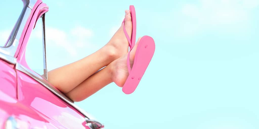 girl legs in pink flip flops, hanging out of a pink car - new driver