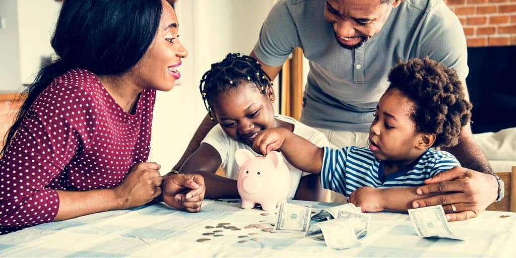 young family at kitchen table, doing money activities with kids