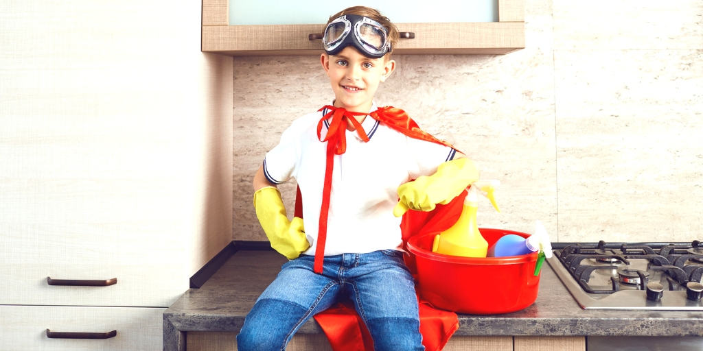 tween boy with superman cape, yellow gloves, bucket of cleaning supplies