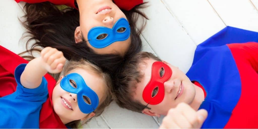 family of super heroes looking at up camera