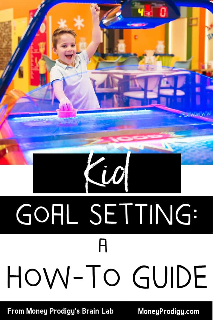 "boy playing air hockey and celebrating with hand in air with text overlay ""kid goal setting: a how-to guide"""