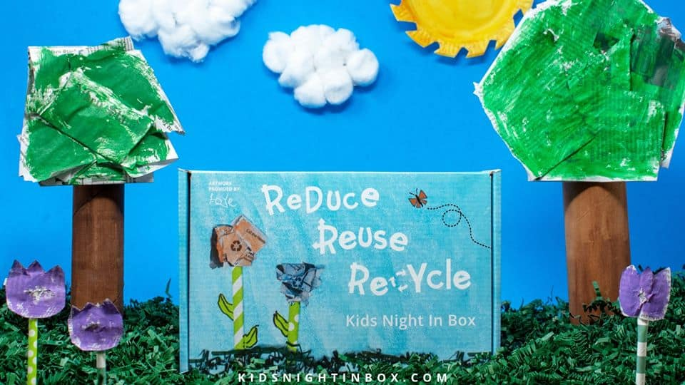 """kids subscription box says """"reduce, reuse, recycle"""" on blue background with clouds"""