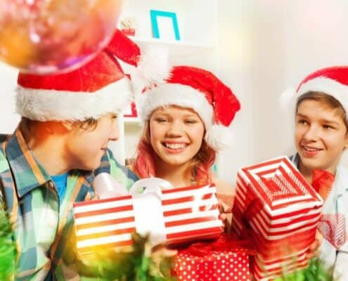 group of kids and teens with money gifts they're excited to open