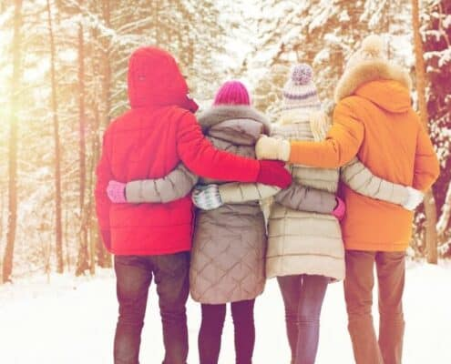 group of teen couples on double date in winter woods