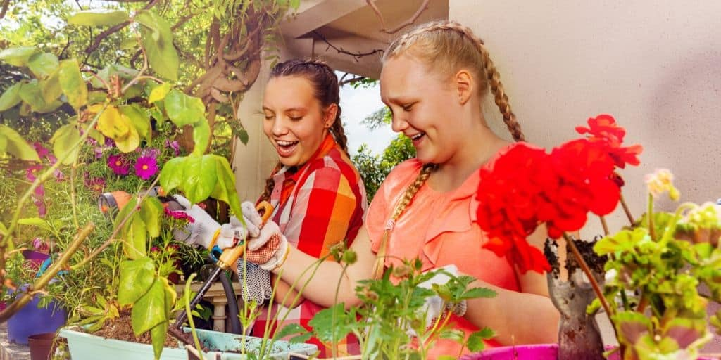 two teen girls working on a plant and flower kid business that makes money