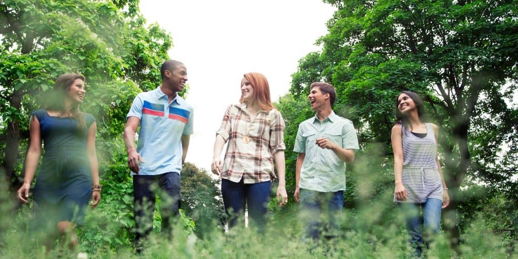 group of teen students walking in a field, talking about career exploration and career research for students