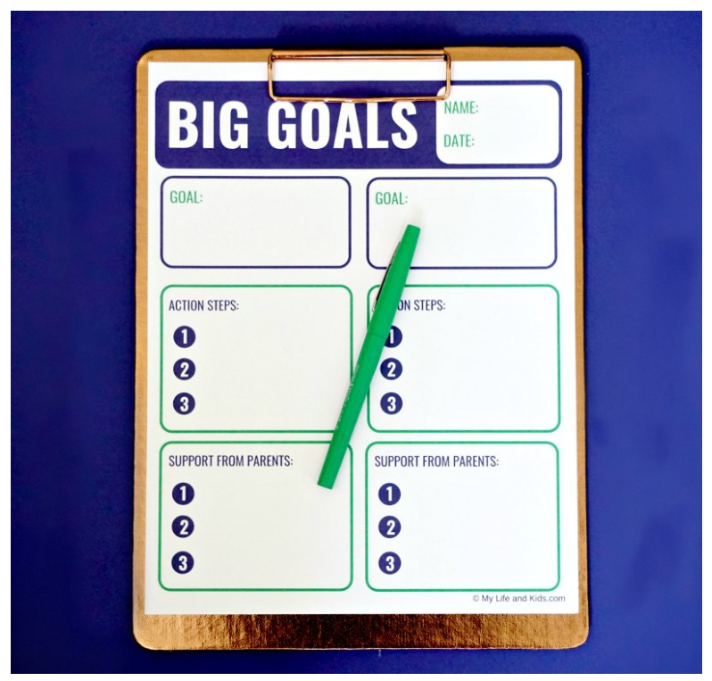 Screenshot of big goals downloadable worksheet for teens on navy blue background with green pen