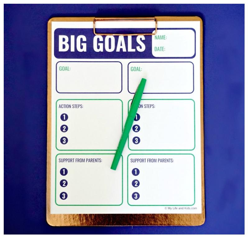 Screenshot of big goals downloadable worksheet for teens on navy blue background with green pen