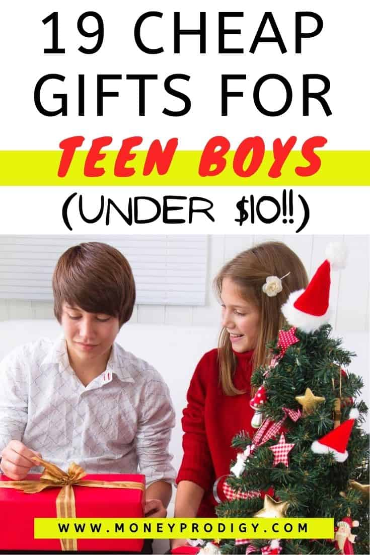 teen boy opening up gift with teen girl at Christmas tree, text overlay