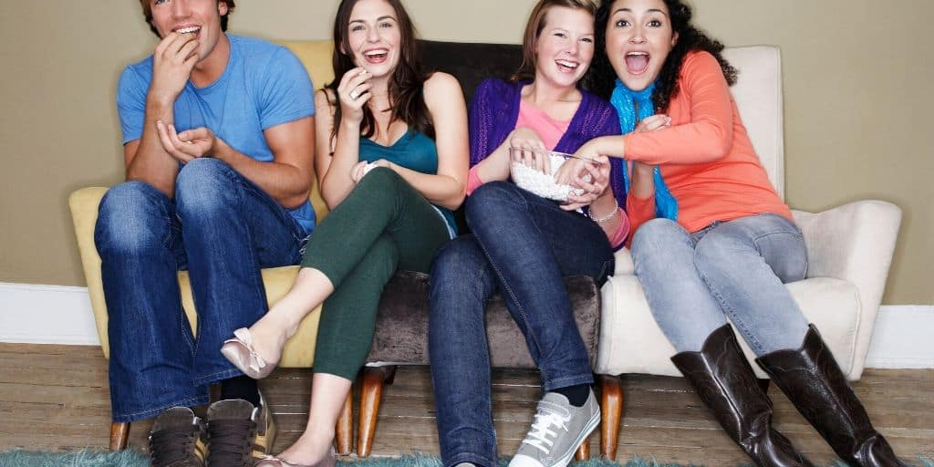 group of teens at party, doing teen party games
