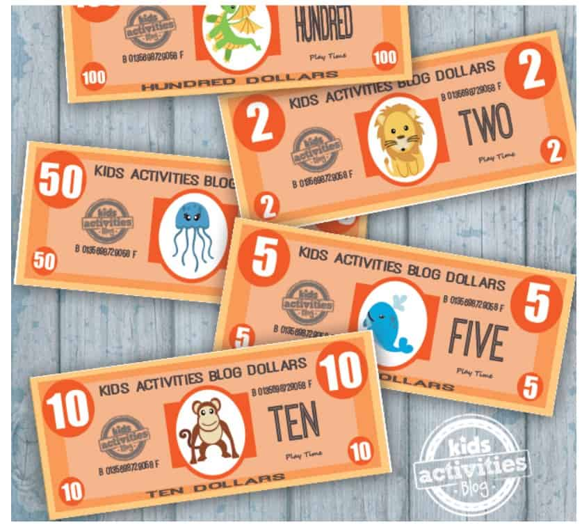 screenshot of free printable cash on paper with animals - great for preschool money printables