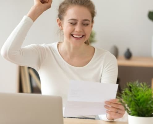 teen girl celebrating job letter - snagged jobs for high school students with no experience