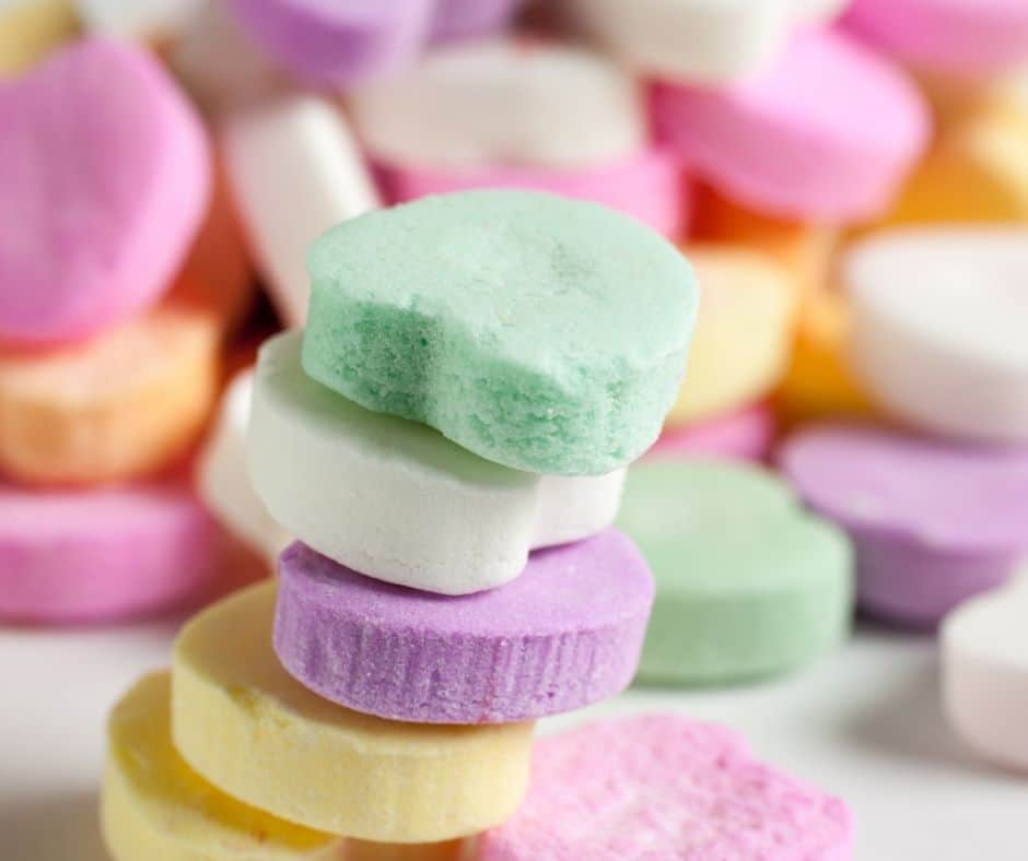 image of valentine's candy hearts stacked, part of a valentine's day activity ideas for teens