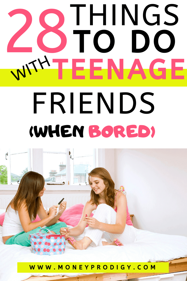 """two teen girls smiling hanging out on bed, text overlay """"28 things to do with teenage friends when bored"""""""