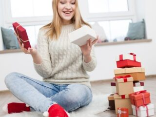 teen girl opening up Christmas eve box for teen