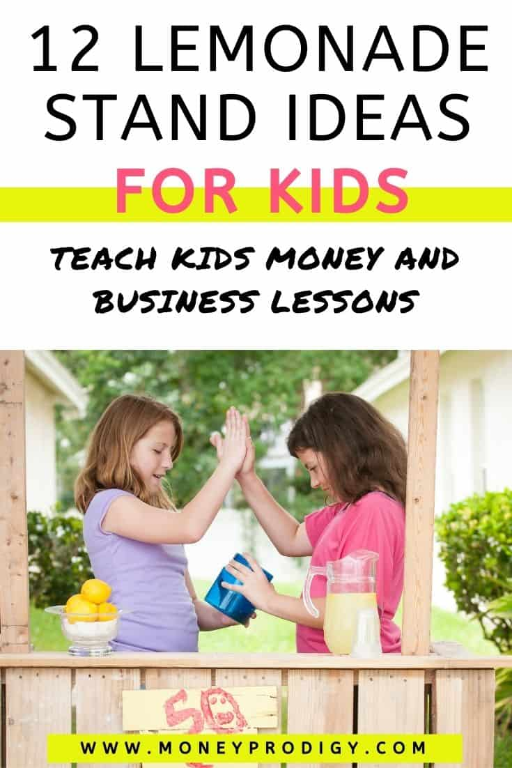 """two girls behind lemonade stand, slapping each other five, text overlay """"12 lemonade stand ideas for kids - teach money and business lessons"""""""